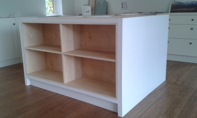 Cabinet installed with sides to form kitchen island.